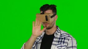 Virtual reality. VR glasses. Green screen. Close up stock video footage