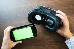 Virtual reality, VR, helmet and smartphone with green screen for key chroma screen. Virtual reality, VR, helmet and smartphone with green screen for key Royalty Free Stock Photos