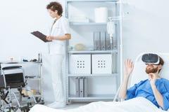 Virtual rehabilitation at psychiatric clinic. Trauma patient during virtual rehabilitation at the psychiatric clinic stock images