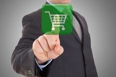 Virtual shopping. Hand pushing virtual symbol of online shopping Stock Photography