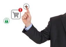 Virtual symbol of online shopping. Hand pushing virtual symbol of online shopping Stock Photography