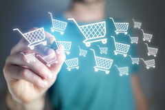 Virtual trolley drawn by a man on a glass - shopping online conc Stock Photography