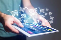 Virtual trolley going out of a tablet - shopping online concept Stock Photos