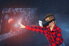 The boy plays virtual educational games . Modern technologies in training stock photo