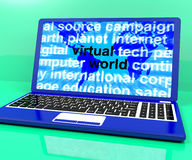 Virtual World Words On Laptop Showing Global Internet Royalty Free Stock Image