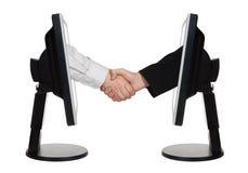 Virtueller Händedruck - Internet-Geschäftskonzept Stockbild