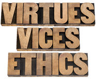 Virtues, vices and ethics words. Virtues and vices  - ethics concept - a collage of isolated text in letterpress wood type Stock Images
