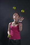 Virtuoso juggle. R- green apples juggling Stock Photography