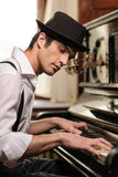Virtuoso playing piano Stock Images