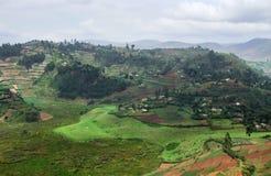 Virunga Mountains aerial view. Aerial view around the Virunga Mountains in Uganda (Africa) in rainy ambiance Stock Photo