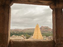 Virupaksha hindu temple gopuram through the Mandapa and ruins, Hampi, India.  stock images