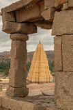 Virupaksha hindu temple gopuram through the Mandapa and ruins, Hampi, India.  stock photography