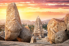 Virupaksha temple in Hampi. Virupaksha temple view from Hemakuta hill at sunset in Hampi, Karnataka, India royalty free stock image