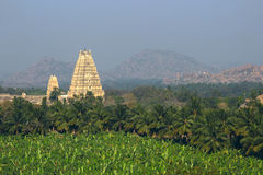 Virupaksha Temple among mountains and palm plantations on sunrise Royalty Free Stock Images