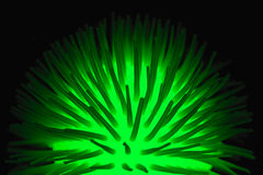 Virus. Luminous green ball on a dark background Stock Images
