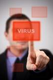 Virus alert. Business man pressing a virus alert button stock photos