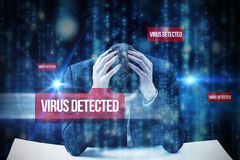 Virus detected against lines of blue blurred letters falling Stock Photo