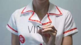 VIRUS, Female doctor writing on transparent screen. VIRUS, Female doctor in white gown writing on transparent screen stock video footage