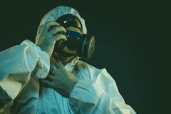 virus infection concept. Man in protective suit and antigas mask stock photos