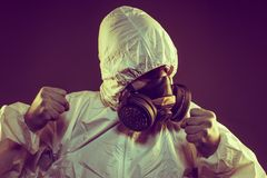 virus infection concept. Man in protective suit and antigas mask royalty free stock images