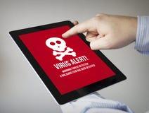 Virus op een tablet Stock Afbeeldingen