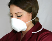Virus protection. A Nurse wears a face mask to protect against infection royalty free stock photography
