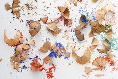 Virutas coloridas de los creyones de los lápices Foto de archivo libre de regalías