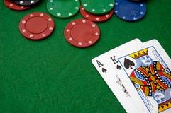 Virutas de póker y AK Foto de archivo libre de regalías