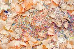 Virutas del creyón en el fondo blanco Fotografía de archivo libre de regalías