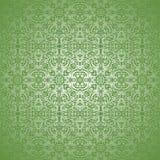 Virvel för tapetsilverBatik på grön bakgrund Arkivbild
