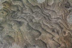 Virvlad runt sandbakgrund arkivfoton