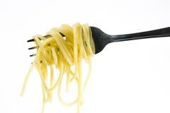 Virvlar av lagad mat spagetti Arkivfoto