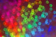 Visão de muitos pontos obscuros com efeito do bokeh de muitas cores Imagens de Stock