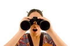 Visão desgastando fêmea do quimono através dos binóculos Fotografia de Stock