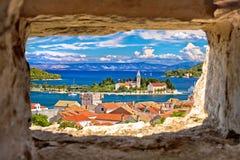 Vis bay waterfront view through stone window Royalty Free Stock Photo