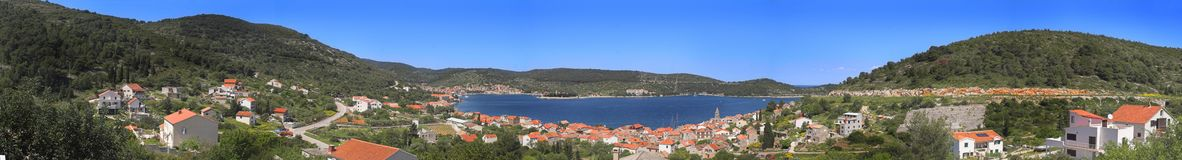 Vis island in Croatia. Panoramic view of Vis island with the town in the foreground, Croatia Royalty Free Stock Photography