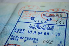 Visa. An old chinese visa with stamps royalty free stock images