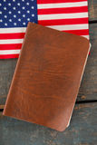Visa and American flag on a wooden table. Close-up of visa and American flag on a wooden table stock image