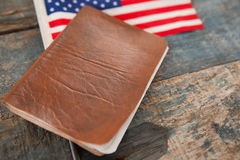 Visa and American flag on a wooden table. Close-up of visa and American flag on a wooden table royalty free stock photo