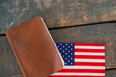 Visa and American flag on a wooden table. Close-up of visa and American flag on a wooden table royalty free stock photography