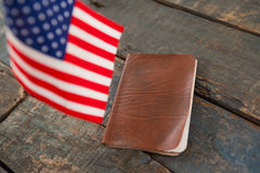 Visa and American flag on a wooden table. Close-up of visa and American flag on a wooden table royalty free stock images
