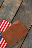 Visa and American flag on a wooden table. Close-up of visa and American flag on a wooden t stock photo