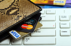 Visa And Mastercard Credit Cards In Wallet Over Notebook Keyboard Stock Photography