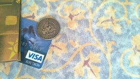 Visa bank card and half dollar coin royalty free stock photo