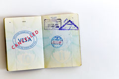 Visa cancelled stamp in passport. Visa cancelled and customs stamps in passport Stock Images