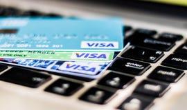 Visa card. BANGKOK, THAILAND - JULY 21, 2017: closeup shot of credit card issued by VISA on computer keyboard Royalty Free Stock Photos