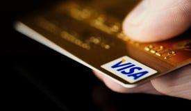 VISA card in hand stock photos
