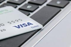 Visa Card on a laptop keyboard Royalty Free Stock Images