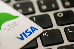 Visa card laying on laptop. MAY 4, 2015: A bank credit card Visa laying on laptop keboard stock photography