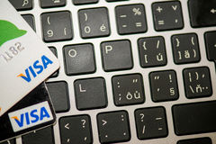 Visa cards laying on laptop. MAY 4, 2015: Two bank credit cards Visa laying on laptop keboard royalty free stock photography